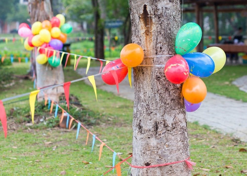 Backyard decorated for an outdoor carnival for kids