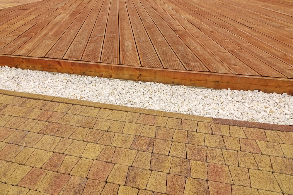 Wooden deck versus brick patio