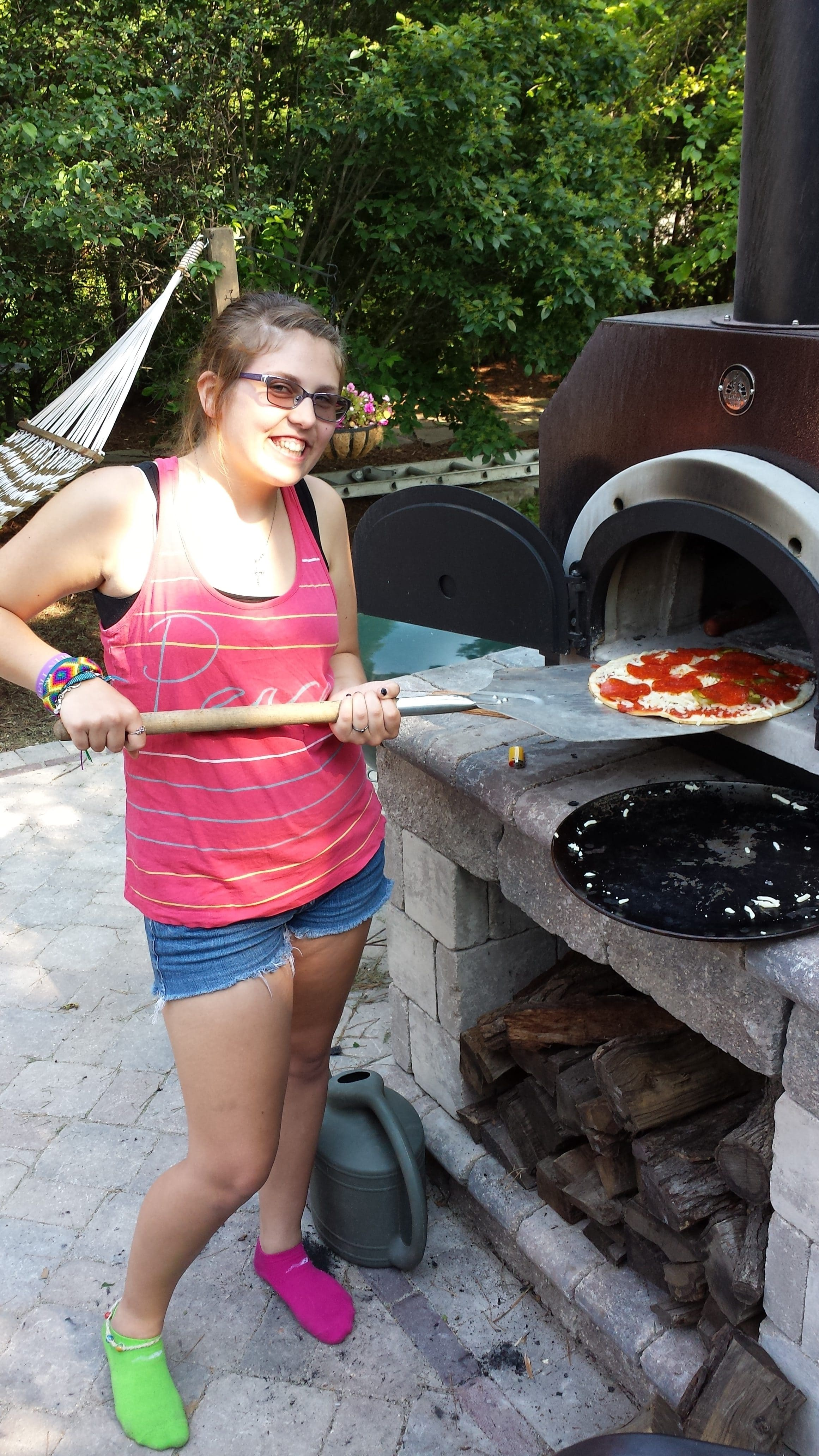 making pizza in a pizza oven