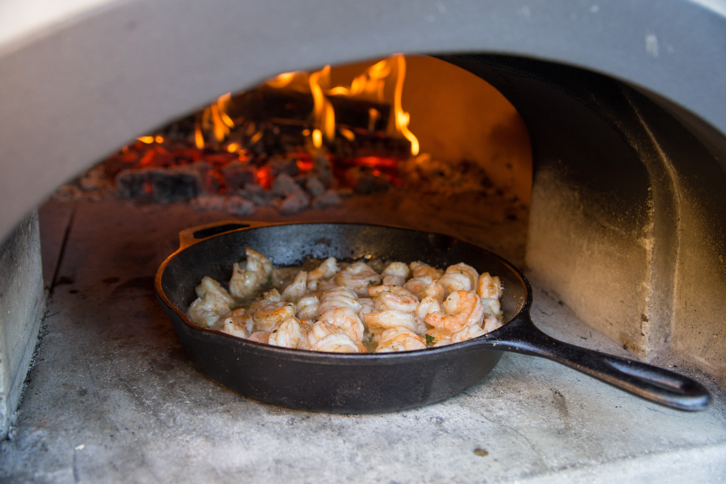 shrimp cooked up in a pizza oven