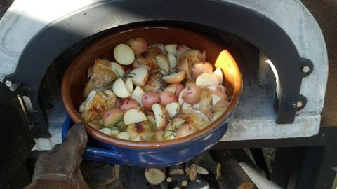 rosemary checken and potatoes cooked up in a pizza oven